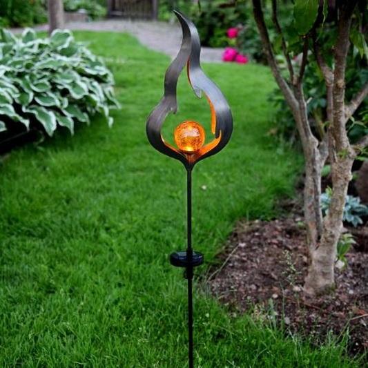 Melilla flamma på pinne med amber glaskula, solcell